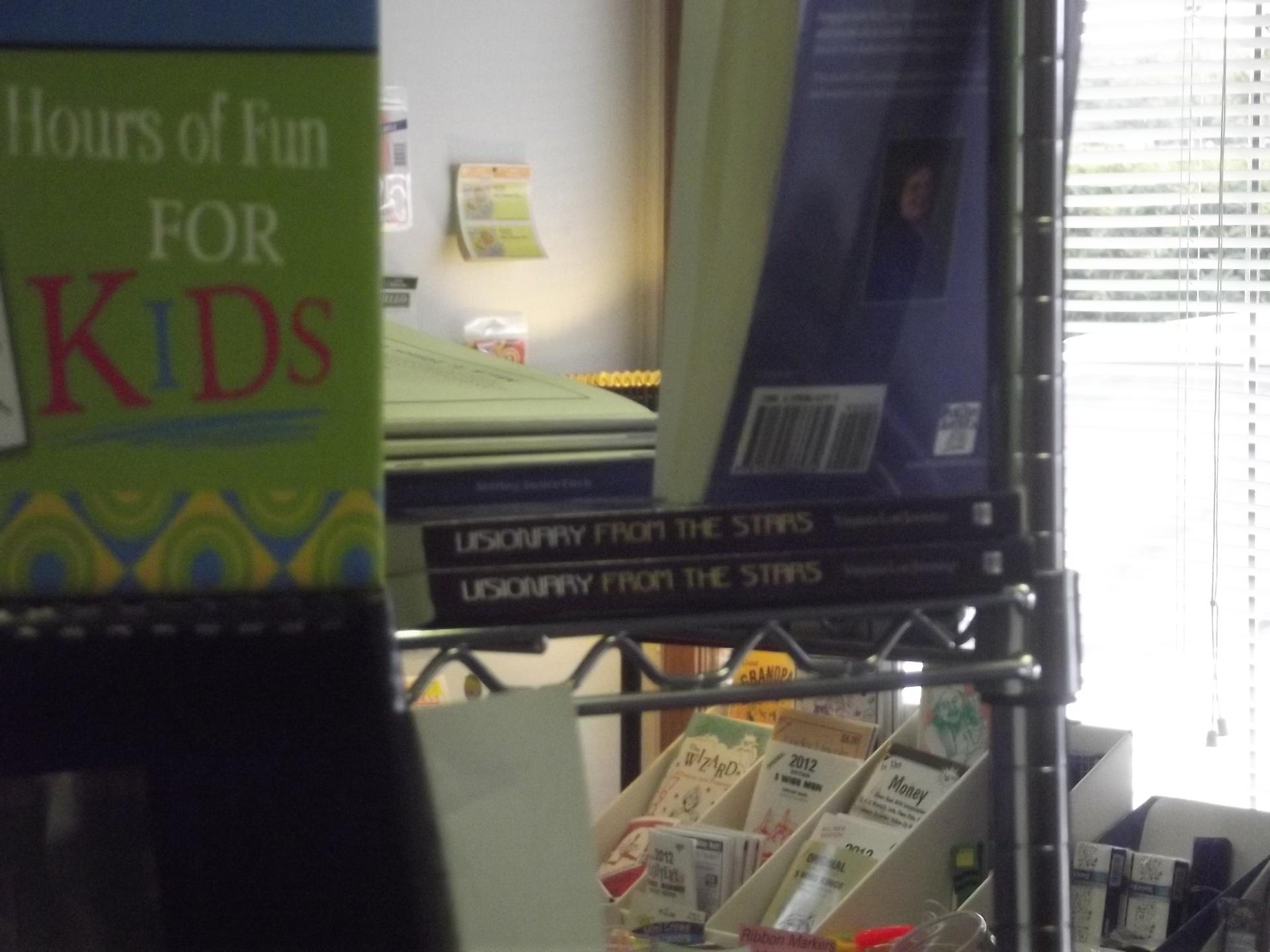 My books on a shelf in a Bookstore!